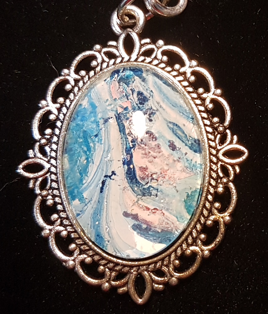 Picture of a blue and pink abstract painting in a pendant